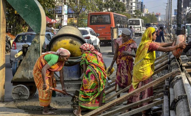 Women work at a construction site, a day before International Women\'s Day in Guwahati. PTI