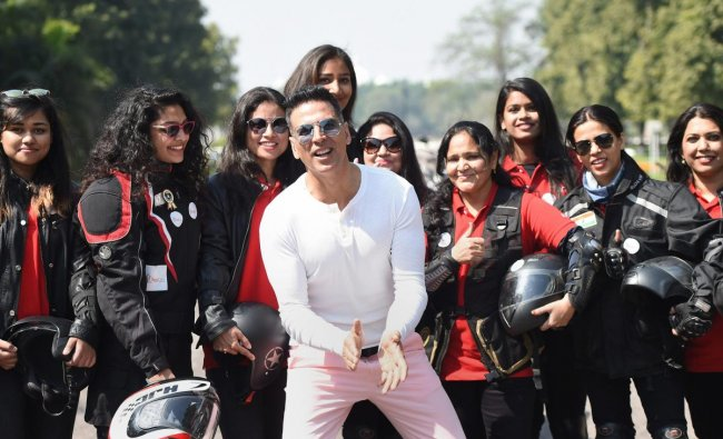 Lucknow: Bollywood actor Akshay Kumar poses with women bike riders during an event to mark International Women's Day, in Lucknow, Friday, March 8, 2019. (PTI Photo/Nand Kumar)