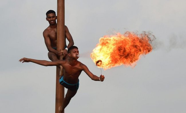 Chennai: Cadets demonstrate \'Malkhambh\' and fire-eating skill during the combined display of martial arts and combat skills at Officers Training Academy (OTA) in Chennai, Friday, March 8, 2019. (PTI Photo)