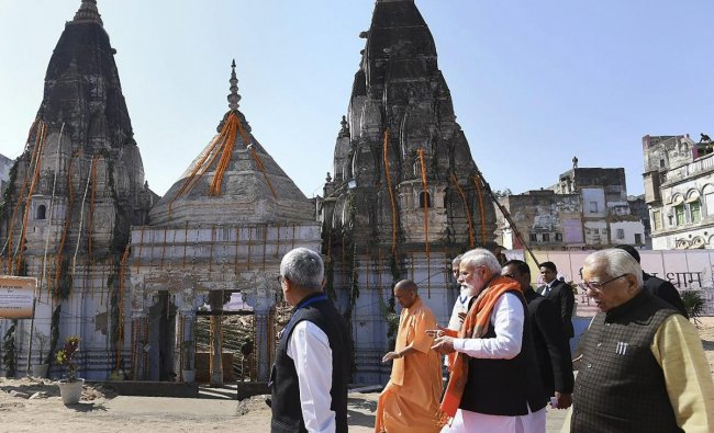 Prime Minister Narendra Modi visits Kashi Vishwanath Temple in Varanasi, Friday, March 8, 2019. Uttar Pradesh Governor Ram Naik and Chief Minister Yogi Adityanath are also seen. (PIB/PTI Photo)