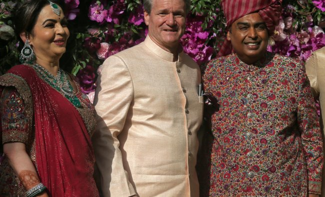 Mukesh Ambani, the Chairman of Reliance Industries, his wife Nita Ambani and Brian T. Moynihan, CEO of the Bank of America Corporation, pose during a photo opportunity at the wedding ceremony of Mukesh\'s son Akash Ambani at Bandra-Kurla Complex in Mumbai, India, March 9, 2019. REUTERS/Francis Mascarenhas