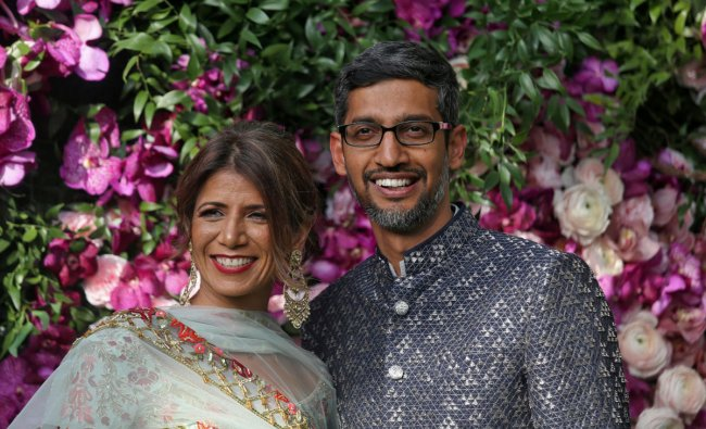 Google CEO Sundar Pichai and his wife Anjali Pichai pose during a photo opportunity at the wedding ceremony of Akash Ambani, son of the Chairman of Reliance Industries Mukesh Ambani, at Bandra-Kurla Complex in Mumbai, India, March 9, 2019. REUTERS/Francis Mascarenhas