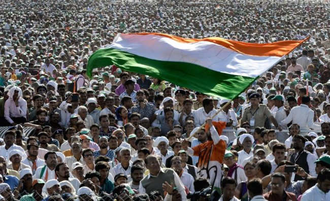 Gandhinagar: Congress supporters wave the tricolour as they cheer during the party\'s public rally, in Gandhinagar, Tuesday, March 12, 2019. (PTI Photo)