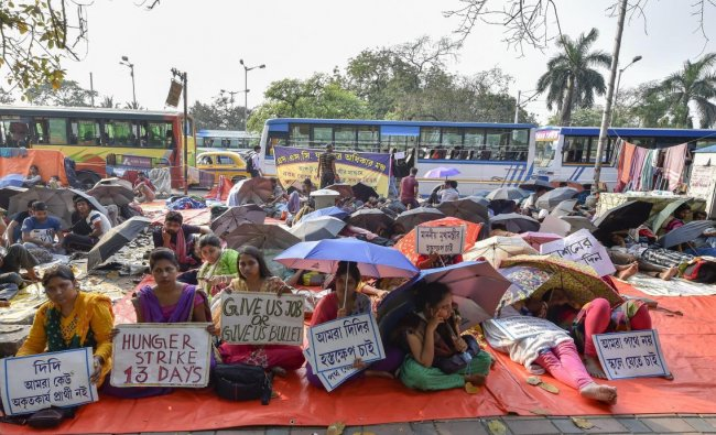 West Bengal School Service Commission (SSC) candidates sit on an indefinite hunger strike to press for their demands, in Kolkata, Tuesday, March 12, 2019. (PTI Photo/Ashok Bhaumik)