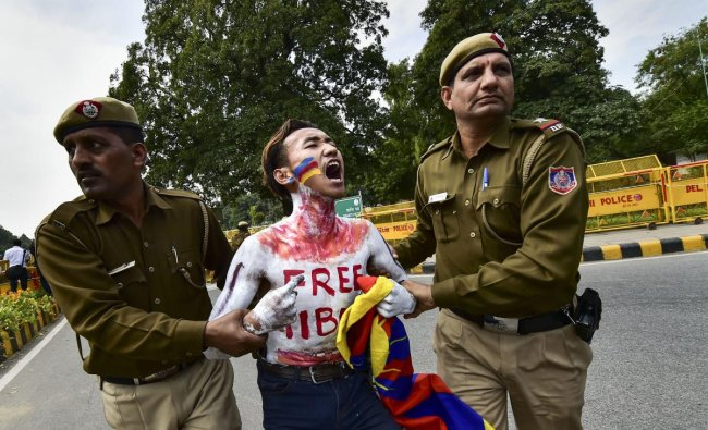 Police personnel detain Tibetan activists during their protest to commemorate the anniversary of 1959 Tibetan uprising against Chinese rule, near the Chinese embassy in New Delhi, Tuesday, March 12, 2019. (PTI Photo/Arun Sharma)