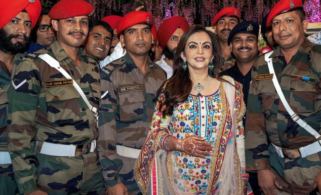 Reliance Foundation Founder & Chairperson Nita M Ambani poses for photos with armed forces' jawans at the special Musical Fountain show at Dhirubhai Ambani Square as a post-wedding celebration, in Mumbai, Tuesday, March 12, 2019. (PTI Photo)