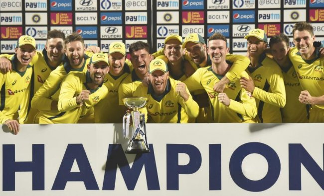 Australian cricketers pose with trophy after winning the fifth One-Day International (ODI) cricket match and series against India at the Feroz Shah Kotla Ground, in New Delhi, Wednesday, March 13, 2019. (PTI Photo/Ravi Choudhary)