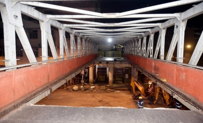 A view of the partially collapsed foot overbridge in south Mumbai. The bridge connected the bustling Chhatrapati Shivaji Maharaj Terminus railway station with the Azad Maidan Police Station. (PTI Photo)