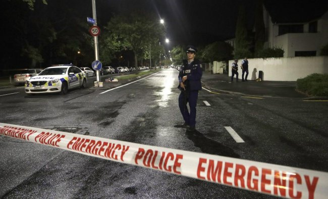 A police officer patrols at a cordon near a mosque in central Christchurch, New Zealand. Multiple people were killed in mass shootings at two mosques full of worshippers attending Friday prayers on what the prime minister called \