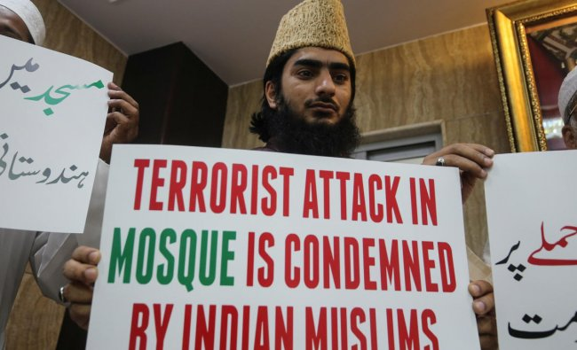 A man holds a placard to condemn Christchurch mosque attack in New Zealand, at a madrasa in Mumbai. (Reuters Photo)