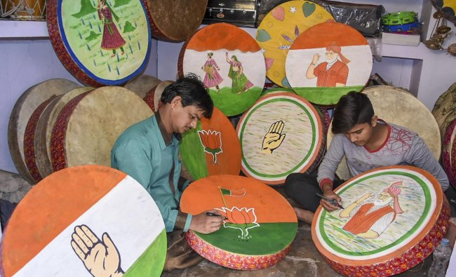 Artisans paint drums with party symbols ahead of Lok Sabha election 2019 in Jodhpur. (PTI Photo)