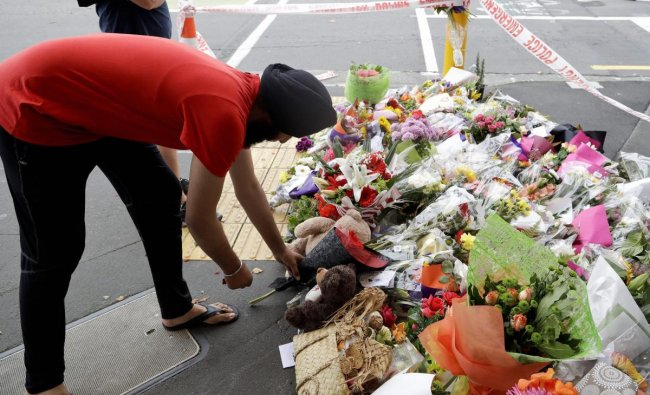 A man places flowers at a makeshift memorial near the Masjid Al Noor mosque in Christchurch, New Zealand, where one of the two mass shootings occurred. (AP/PTI Photo)