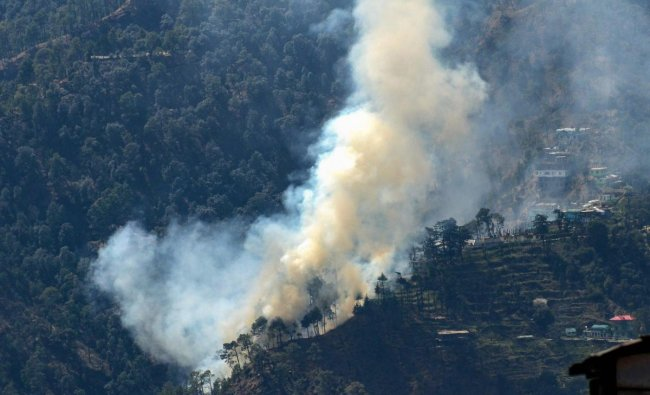 Smoke rises from a forest fire that broke out near Taradevi temple, in Shimla. (PTI Photo)