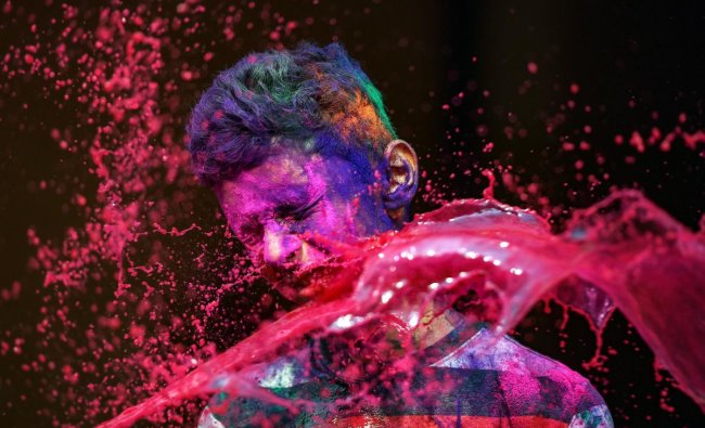 People splash colour water at each other during \'Holi\' celebrations in Chennai. (PTI Photo)