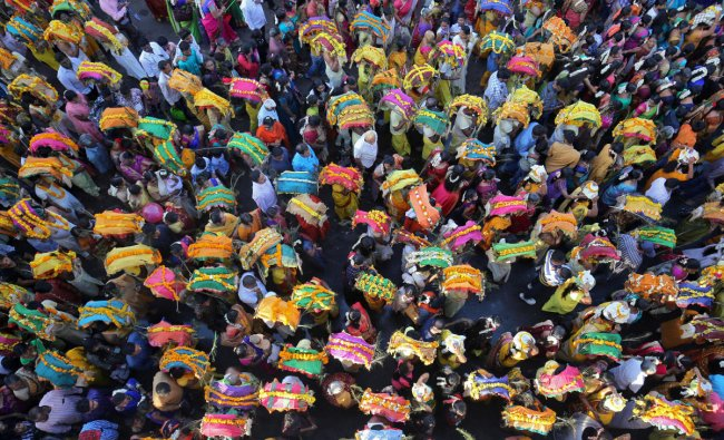 Devotees take part in a procession during the religious festival of Panguni Uthiram in Ahmedabad. (Reuters Photo)