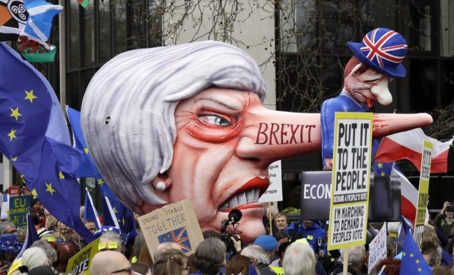 A doll resembling British Prime Minister Theresa May stands among demonstrators during a Peoples Vote anti-Brexit march in London, Saturday, March 23, 2019. The march, organized by the People\'s Vote campaign is calling for a final vote on any proposed Brexit deal. This week the EU has granted Britain\'s Prime Minister Theresa May a delay to the Brexit process. AP/PTI