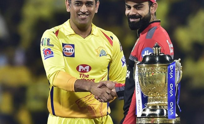Skipper MS Dhoni of Chennai Super Kings and Skipper Virat Kohli of Royal Challengers Bangalore during the first match of 12th edition of the Indian Premier League 2019 T20 cricket tournament between Chennai Super Kings and Royal Challengers Bangalore at MAC Stadium in Chennai, Saturday, March 23, 2019. (PTI Photo)