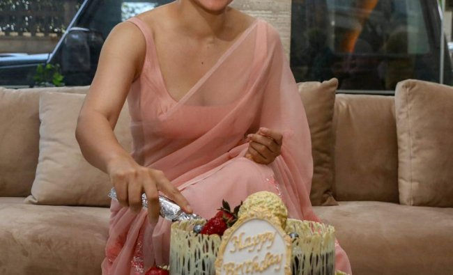 Bollywood actor Kangana Ranaut poses for photographs on her 32nd birthday celebration, at her residence in Mumbai, Saturday, March 23, 2019. (PTI Photo)