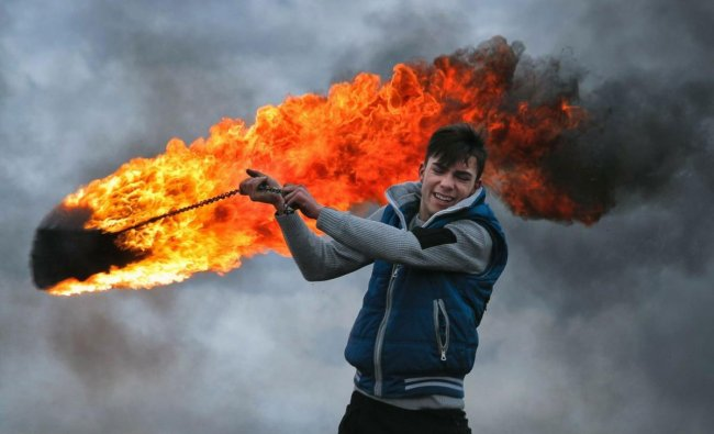 A young man spins a burning tire on a metal chain, during a ritual marking the upcoming Clean Monday, the beginning of the Great Lent, 40 days ahead of Orthodox Easter, on the hills surrounding the village of Poplaca, in central Romania\'s Transylvania region. PTI