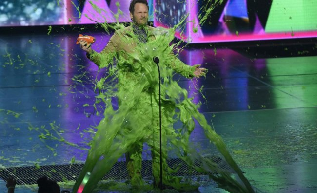 Chris Pratt gets slimed as he accepts the award for favorite butt-kicker for \