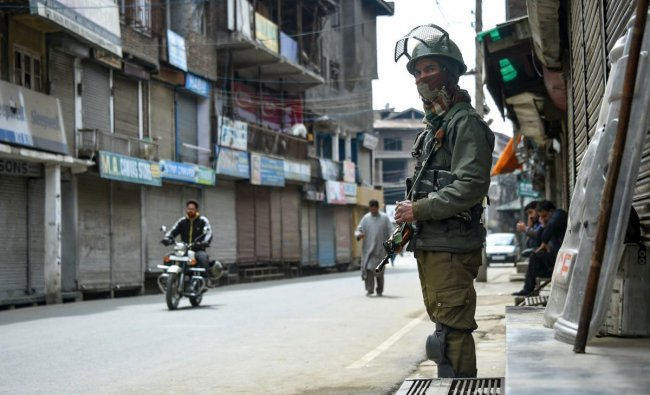 A security personnel stands guard outside Jammu and Kashmir Liberation Front (JKLF) headquarters during a strike, in Srinagar, Sunday, March 24, 2019. Separatist groups called for strike to protest against the ban on JKLF led by Yasin Malik. (PTI Photo)