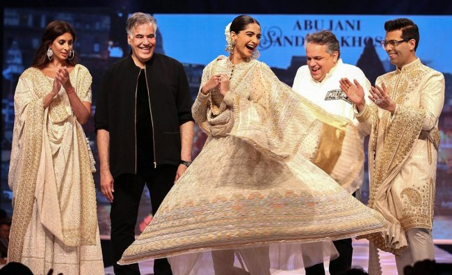 Bollywood actor Sonam Kapoor Ahuja, film director Karan Johar and Shweta Bachchan Nanda walk the ramp showcasing work of fashion designers Abu Jani and Sandeep Khosla during the 14th annual 'Caring with Style' fashion show in association with the Cancer Patients Aid Association, in Mumbai, Sunday, March 24, 2019. (PTI Photo)