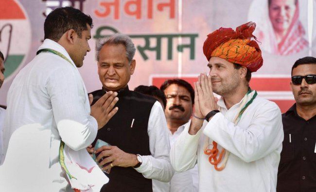 Congress President Rahul Gandhi is greeted by his party worker as Rajasthan Chief Minister Ashok Gehlot looks on during a public meeting, ahead of the Lok Sabha elections, in Bundi district, Tuesday, March 26, 2019. (PTI Photo)