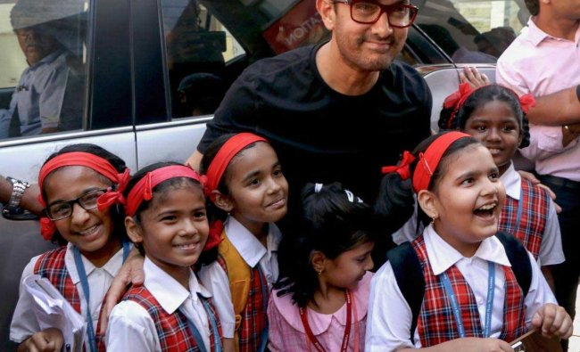 Bollywood actor Aamir Khan poses with children, in Mumbai, Wednesday, March 27, 2019. (PTI Photo)