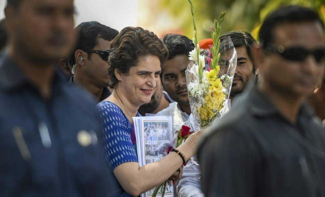 Congress General Secretary UP-East Priyanka Gandhi Vadra is greeted by party leaders and workers on her arrival at the airport, in Lucknow, Wednesday, March 27, 2019. Priyanka Gandhi is on a three-day visit to Amethi, Rae Bareli and Faizabad for her next leg of campaigning in Uttar Pradesh. (PTI Photo)
