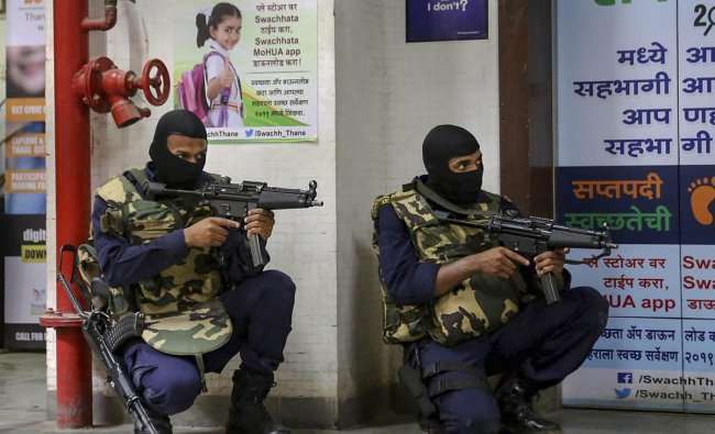 Security personnel stage a mock drill to prepare Thane Municipal Corporation against a terror attack, in Thane, Thursday, March 28, 2019. (PTI Photo)