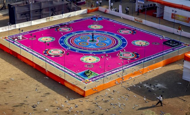 Artists create a 16,000 sq ft \'rangoli\' at Gaondevi ground ahead of Gudi Padwa festival, in Thane, Friday, April 05, 2019. (PTI Photo)