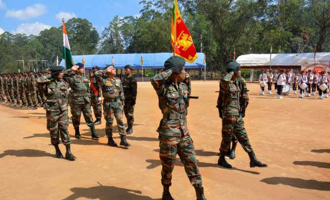 Marching contingents of Indian and Sri Lankan armies during the conclusion ceremony of India-Sri Lank joint exercise \'Mitra Shakti\', in Diyatalawa, Sri Lanka, Monday, April 8, 2019. (PTI Photo)