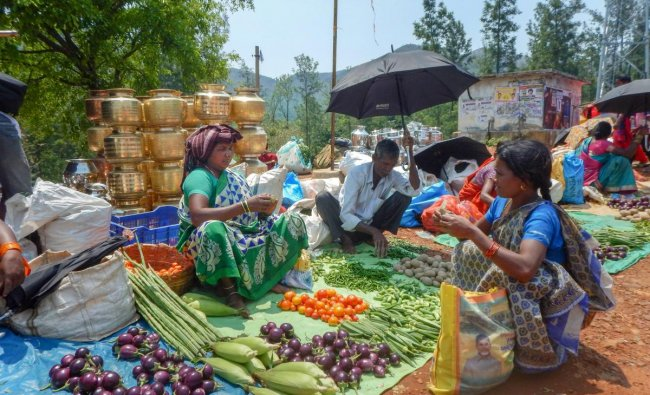 Borra tribals sell vegetables and other produce at a local haat in Araku valley of Vishakapatnam district, Sunday, April 07, 2019. (PTI Photo)