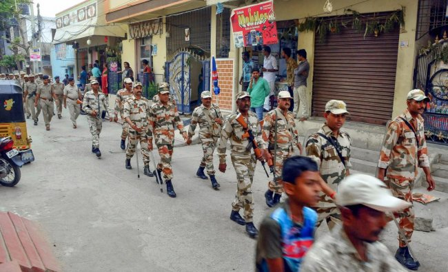 Security forces personnel march in a street on the eve of the 1st phase of 2019 Lok Sabha elections, at Uppaguda in Hyderabad, Wednesday, April 10, 2019. (PTI Photo)