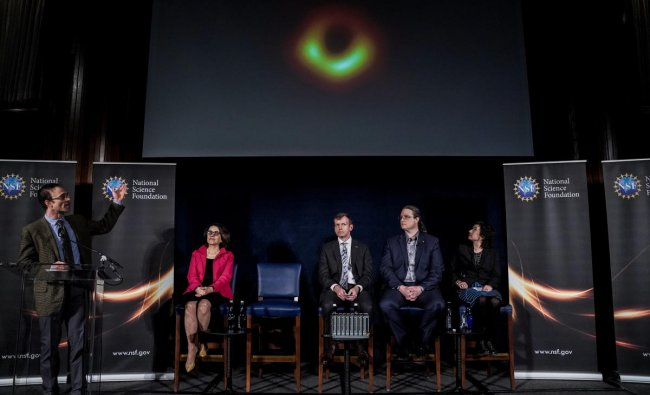 Shepherd Doeleman shows the first image of a black hole during the press conference in Washington, U.S., April 10, 2019. REUTERS