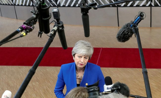 Britain\'s Prime Minister Theresa May speaks to the media as she arrives at an extraordinary European Union leaders summit to discuss Brexit, in Brussels, Belgium April 10, 2019. REUTERS