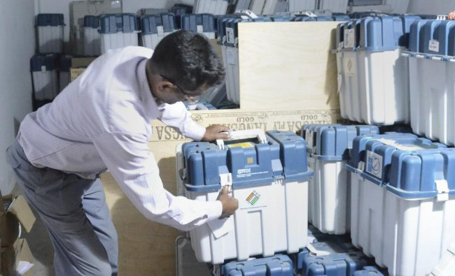 Dibrugarh: A polling officer counts the EVMs (Electronic Voting Machines) kept in a strong room after the first phase of general elections, in Dibrugarh, Friday, April 12, 2019. PTI