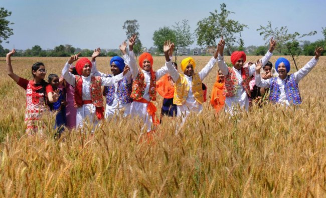 Amritsar: Students in traditional Punjabi attire perform a folk dance as they take part in the Vaisakhi, also known as Baisakhi, celebrations, in Amritsar, Friday, April 12, 2019. PTI
