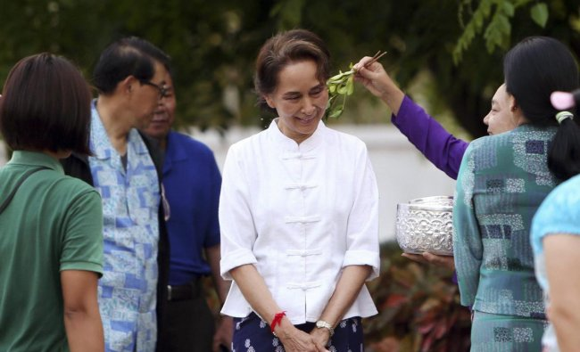 Naypyitaw: Myanmar\'s leader Aung San Suu Kyi, center, is sprinkled with scented water by first lady Cho Cho as they take part in the first day of Myanmar traditional water festival, also known as Myanmar New Year, in Naypyitaw, Myanmar Saturday, April 13, 2019. AP/PTI
