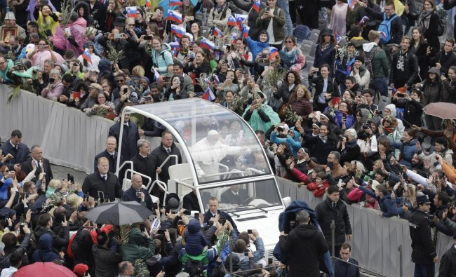 Vatican City: Pope Francis waves to faithful as he leaves St. Peter\'s Square on the popemobile, at the Vatican, Sunday, April 14, 2019. AP/PTI