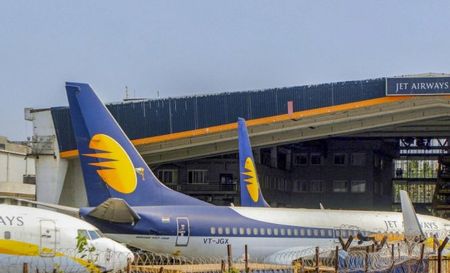 Jet Airways aircrafts seen parked at Chattrapati Shivaji International Airport in Mumbai, Tuesday, April 16, 2019. As trouble at Jet Airways continues to mount, aviation minister Suresh Prabhu has called for a review of issues related to the airline. PTI