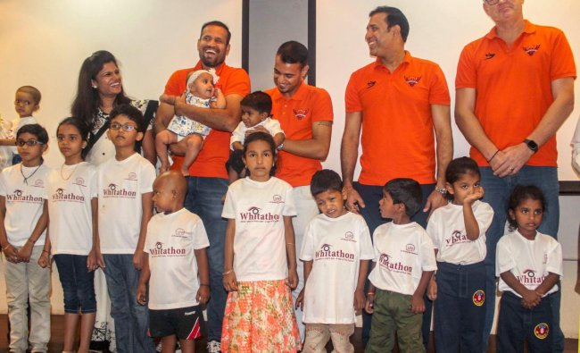 Sunrisers Hyderabad\'s Yusuf Pathan, Siddharth Kaul, VVS Laxman and Tom Moody interact with children suffering from Eye Cancer as they unveil the t-shirts of \'Whitathon 2019\', in Hyderabad, Tuesday, April 16, 2019. PTI