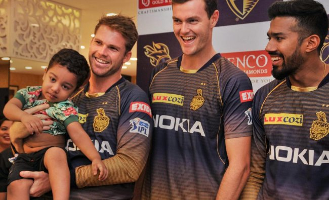 Kolkata Knight Rider (KKR) cricketers Lockie Ferguson (L), Matthew Kelly (C) and Sandeep Warrier pose for a photograph during a promotional event, at Salt Lake City in Kolkata, Wednesday, April 17, 2019. PTI