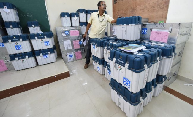 A polling offical counts boxes containing Electronic Voting Machines (EVM) and Voter Verified Paper Audit Trail machines (VVPATs) at a distribution centre, ahead of the second phase of the 2019 Lok Sabha elections, at Nandhanam Arts College in Chennai, Wednesday, April 17, 2019. PTI
