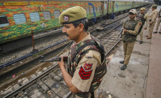 Security personnel stand guard at Jammu railway station in Jammu, Wednesday, April 17, 2019. Security in Jammu and Kashmir has been beefed for the 2nd phase of Lok Sabha elections. PTI