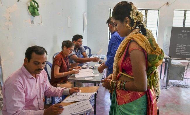 Bengaluru: A bride arrives to cast her vote at a polling station, during the 2nd phase of Lok Sabha elections in Bengaluru, Thursday, April 18, 2019. PTI
