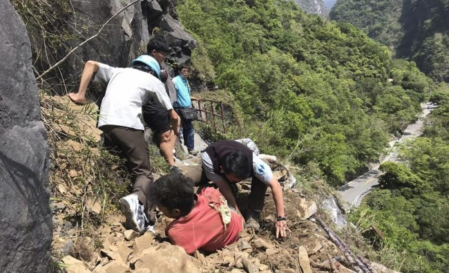 Hualien: In this photo released by Taroko National Park, an injured Malaysian tourist, in red, is assisted by rescue workers at the Taroko National Park in Hualien in eastern Taiwan Thursday, April 18, 2019. A strong earthquake rattled eastern Taiwan early Thursday afternoon, causing scattered light damage in the capital and the eastern coast region. AP/PTI