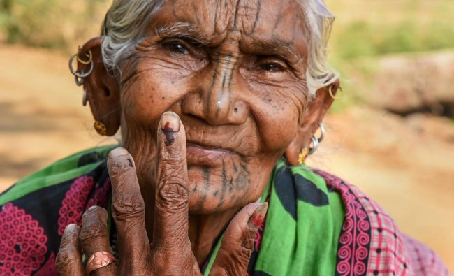 Kandhamaal: An elderly voter show her finger marked with indelible ink at Adabadi polling booth during the second phase of Lok Sabha elections, in Kandhamaal, Thursday, April 18, 2019. PTI