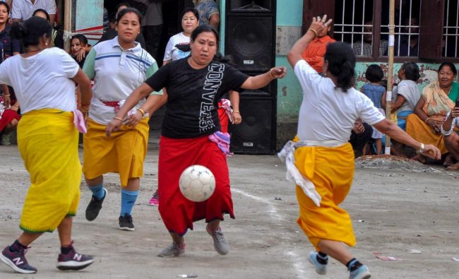 Guwahati: Manipuri women, in their traditional dresses, play football while celebrating their New Year day festival \'Cheiraoba\' in Guwahati, Friday, April 19, 2019