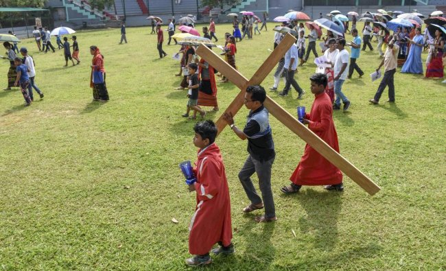Christian devotees arrive to attend a mass prayer to observe Good Friday, in Agatala, Friday, April 19, 2019. (PTI Photo)